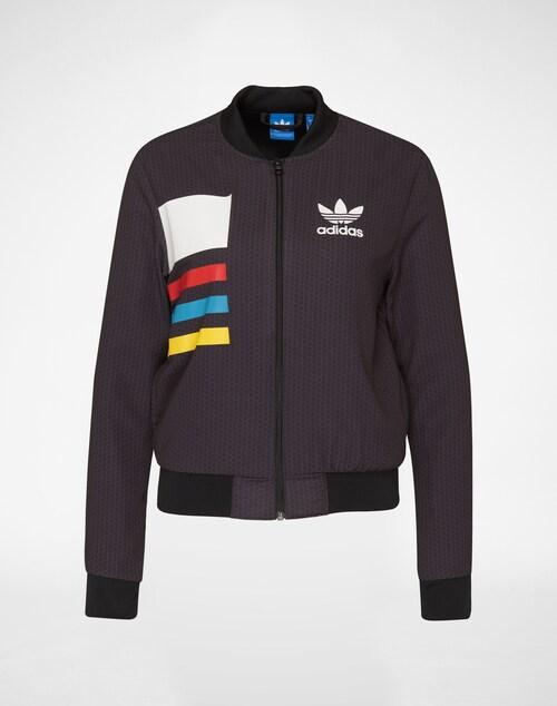 Jacke im Bomber-Stil von Adidas Originals. Mit Rippenbündchen an allen Abschlüssen, coolem Color Block Print und Label-Applikation auf der Brust, entsteht ein sportlich-lässiger Style.