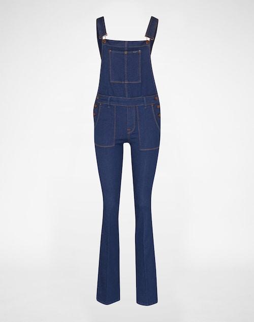 Denim-Latzhose in schmalem Schnitt von Pepe Jeans. Die hinten überkreuzten Träger und das ausgestellte Bein kommen im 70s-Style. Diverse Knöpfe und Nieten im Copper-Look, Gürtelschlaufen und die große aufgesetzte Brusttasche setzten Highlights.